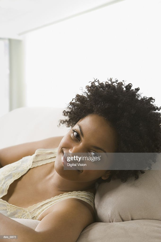 Portrait of a young woman lying down : Foto de stock