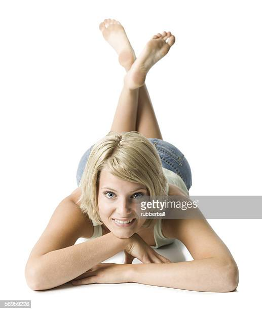 portrait of a young woman lying on the floor - soles pose stock pictures, royalty-free photos & images