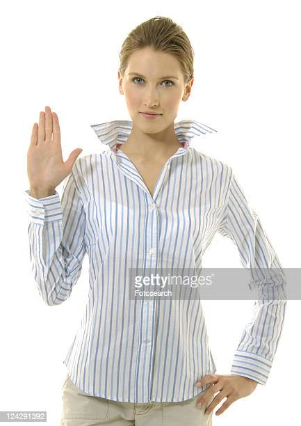 Portrait of a young woman making a stop gesture