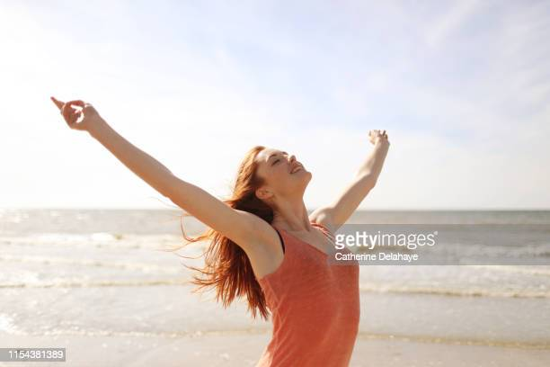 portrait of a young woman on the beach - free stock pictures, royalty-free photos & images