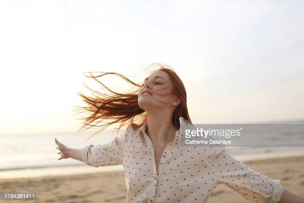 portrait of a young woman on the beach - one young woman only stock pictures, royalty-free photos & images