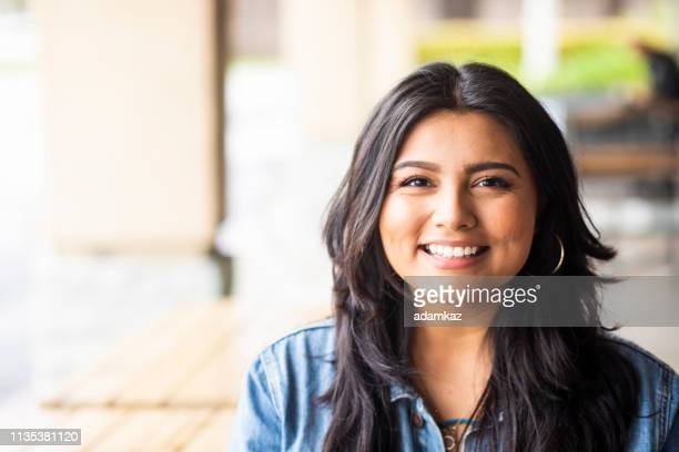 portrait of a young woman outdoors smiling - latin american and hispanic ethnicity stock pictures, royalty-free photos & images