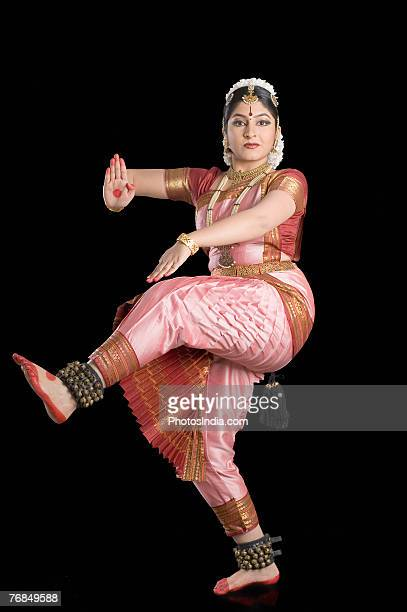 Portrait of a young woman performing Bharatnatyam