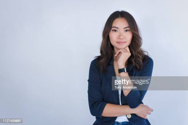 portrait of a young woman - waist up stock pictures, royalty-free photos & images