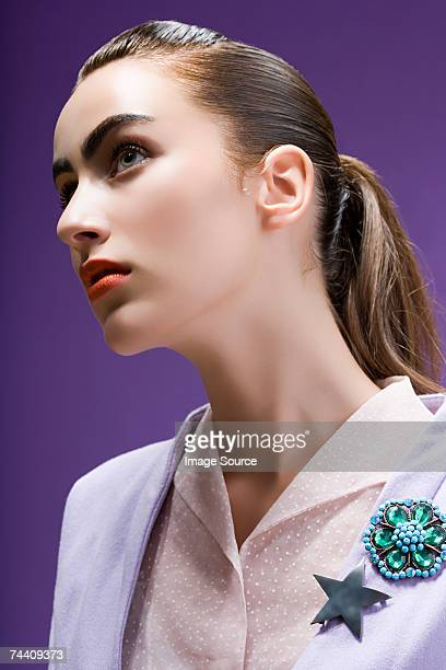 portrait of a young woman - broche stock pictures, royalty-free photos & images