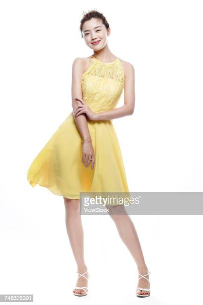 portrait of a young woman - yellow dress stock pictures, royalty-free photos & images