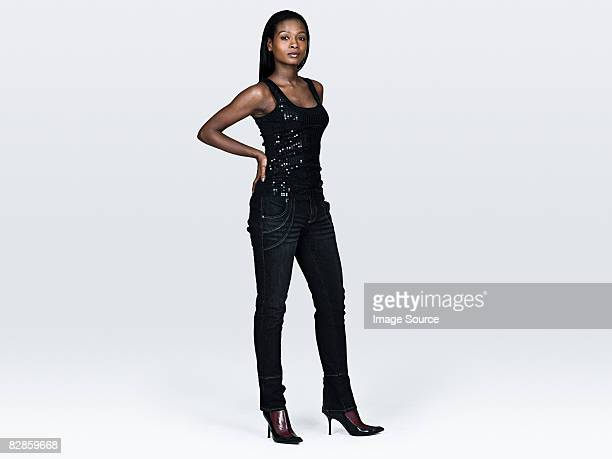 portrait of a young woman - black pants stock pictures, royalty-free photos & images