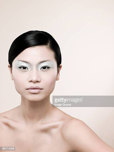 Happy Woman Looking Back Over Shoulder High-Res Stock