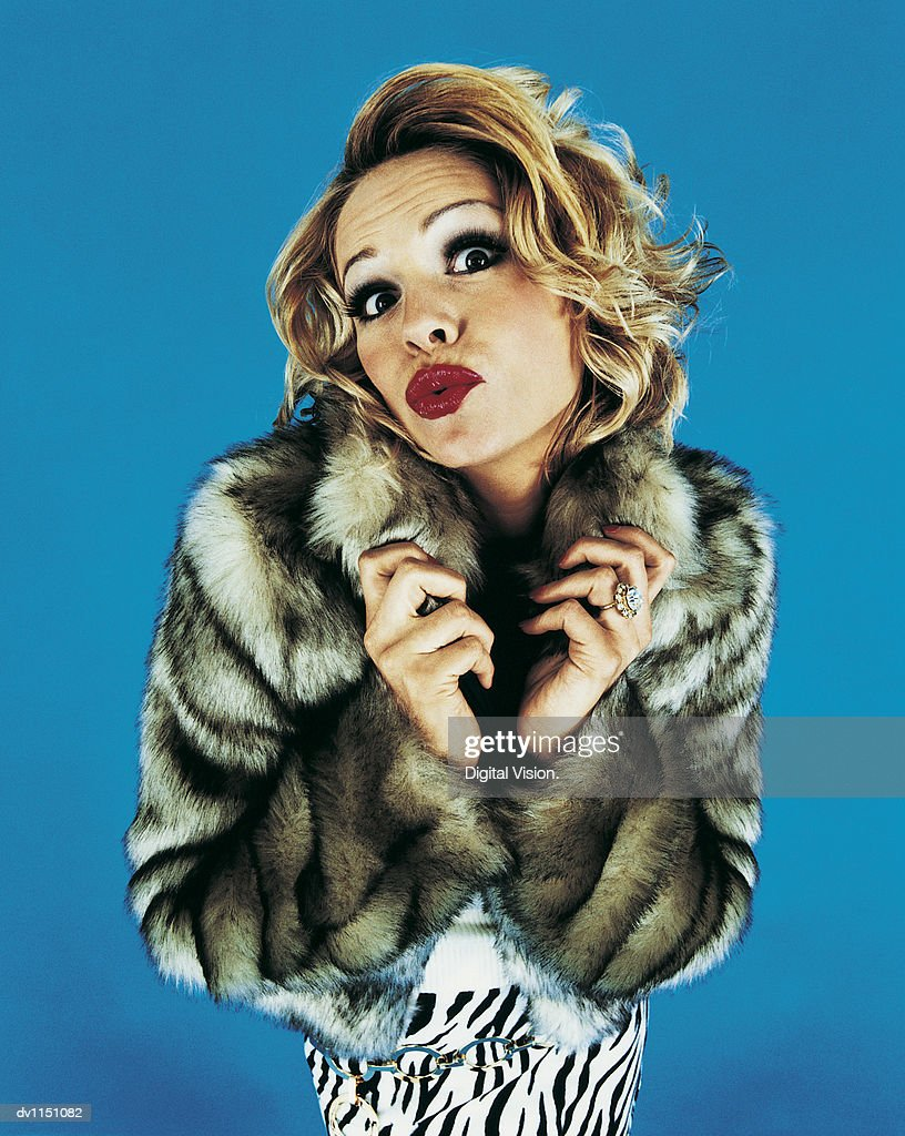 Portrait of a Young Woman Pouting in a Fur Coat : Stock Photo