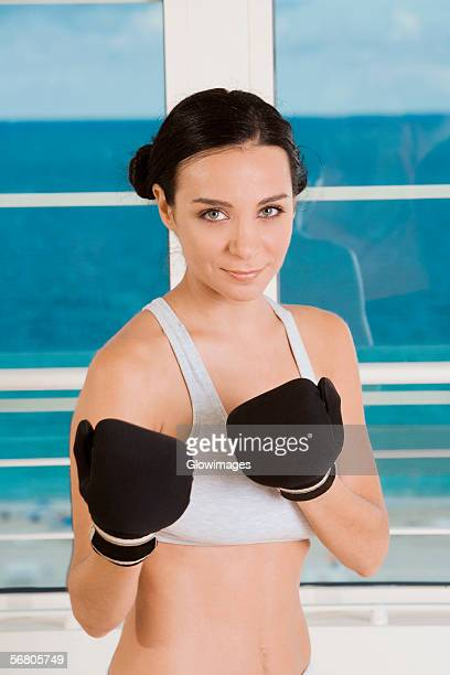 Portrait of a young woman practicing boxing