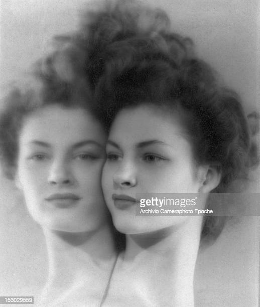 Portrait of a young woman reflecting herself in a mirror circa 1948
