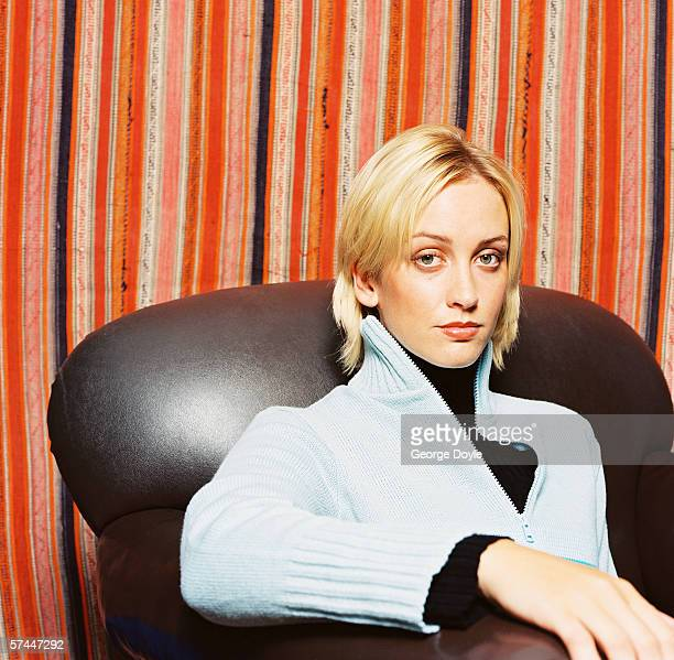 portrait of a young woman sitting on a couch