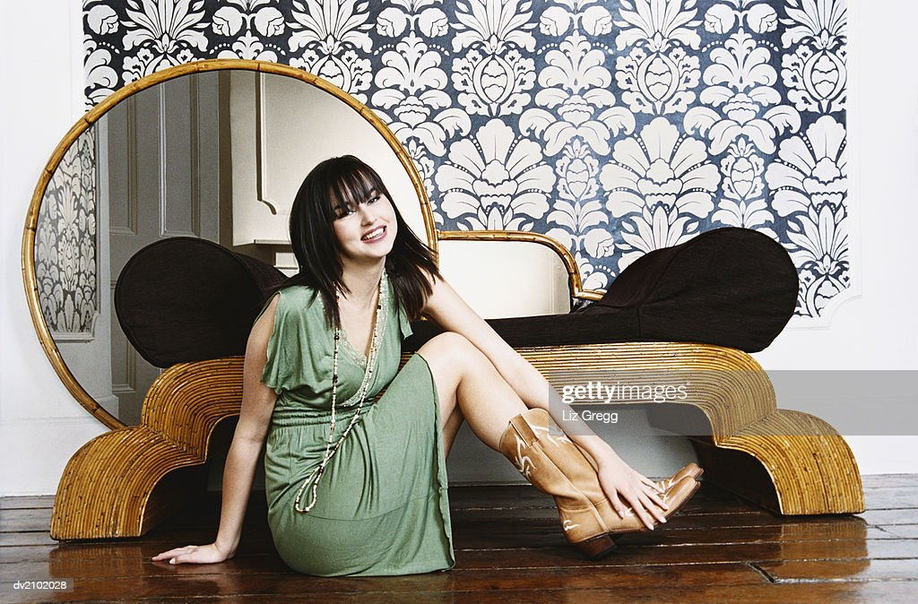Portrait of a Young Woman Sitting on a Wooden Floor : Stock Photo