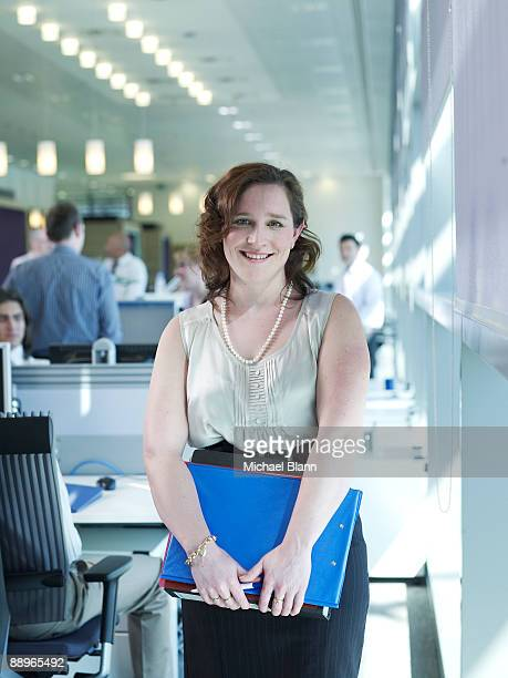 portrait of a young woman smiling in the office