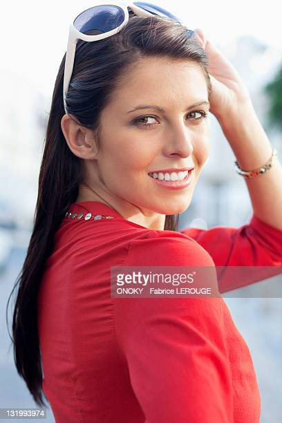 portrait of a young woman smiling - onoky stock-fotos und bilder