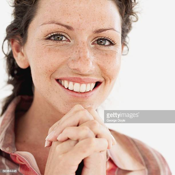 portrait of a young woman smiling - freckle stock photos and pictures
