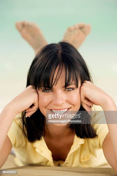 portrait of a young woman smiling - soles pose stock photos and pictures