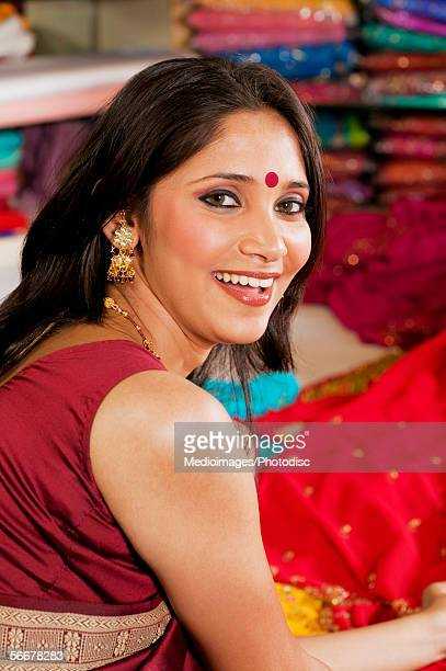portrait of a young woman smiling - bindi stock pictures, royalty-free photos & images