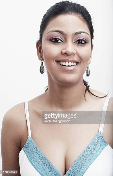 portrait of a young woman smiling - indian cleavage stock pictures, royalty-free photos & images