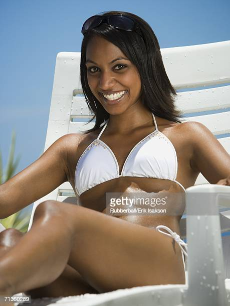 portrait of a young woman smiling - indian bikini stock pictures, royalty-free photos & images