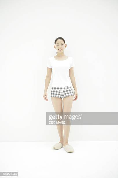portrait of a young woman smiling - スリッパ ストックフォトと画像