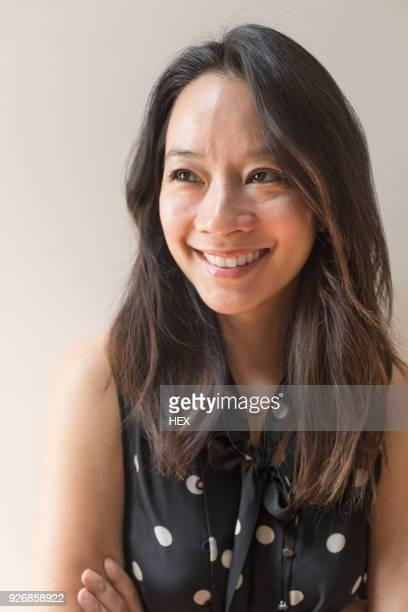 portrait of a young woman smiling - waist up stock pictures, royalty-free photos & images