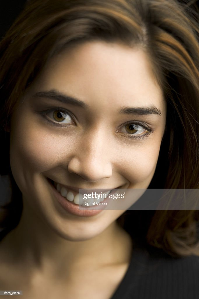 Portrait of a young woman smiling : Foto de stock