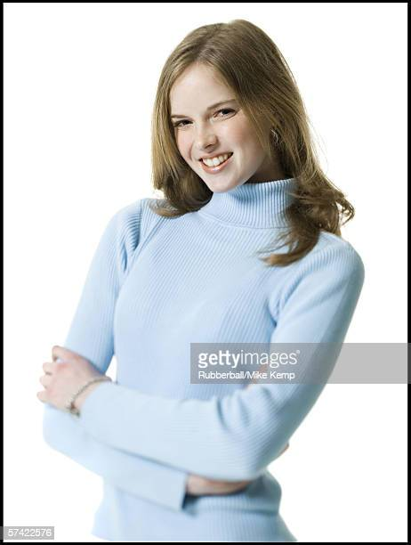 Portrait of a young woman smiling with her arms folded