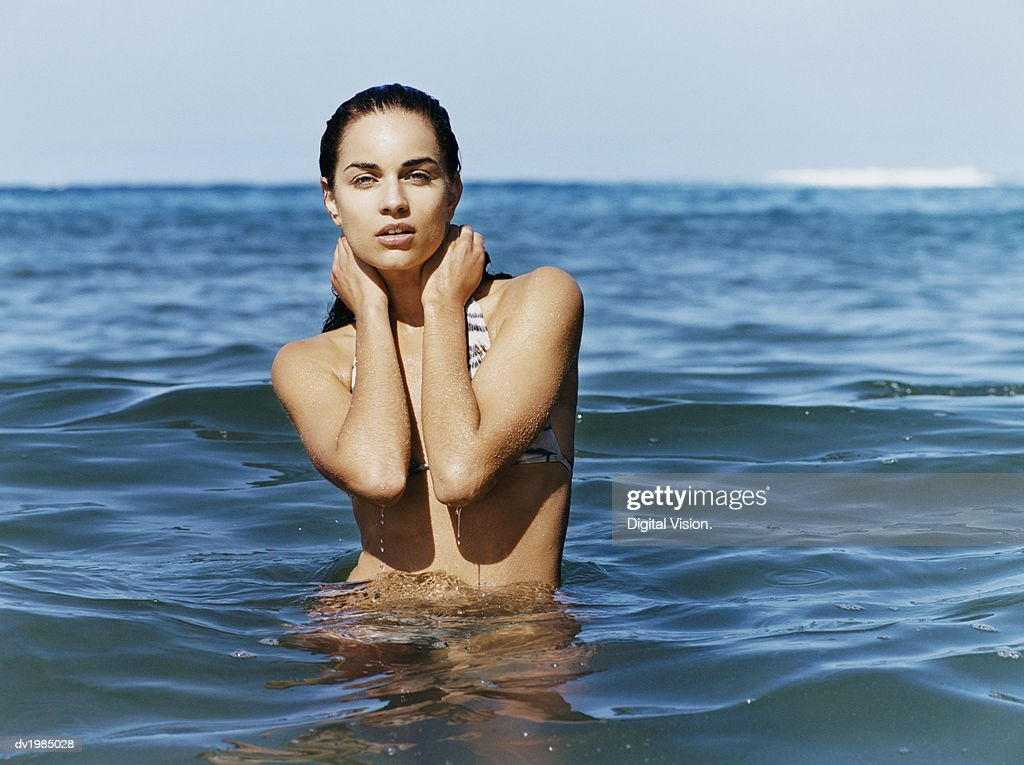 Portrait of a Young Woman Standing in the Sea : Stock Photo