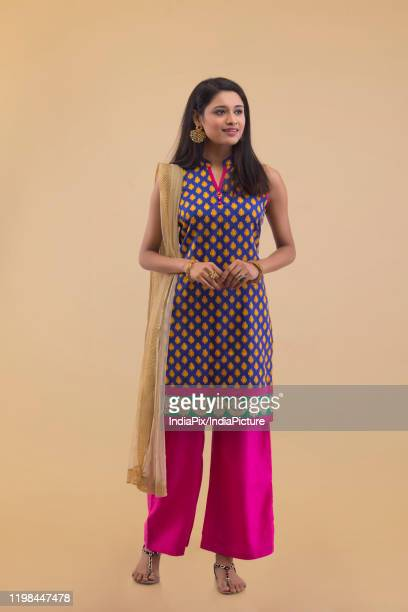 portrait of a young woman standing in traditional dress - salwar kameez stock pictures, royalty-free photos & images