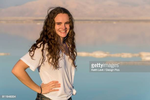 Portrait Of A Young Woman Standing With The Dead Sea In The Background