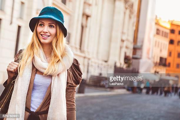 portrait of a young woman walking in the city - mid adult men stockfoto's en -beelden