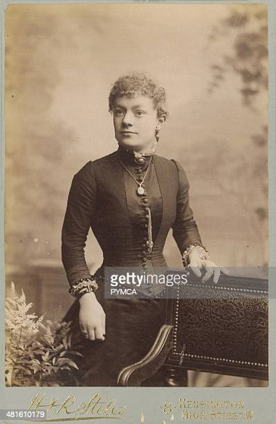 Portrait of a young woman wearing a corset under her dress circa 1890s