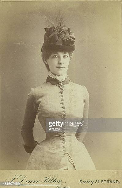 Portrait of a young woman wearing a corset under her dress, Victorian fashion, circa 1890s.