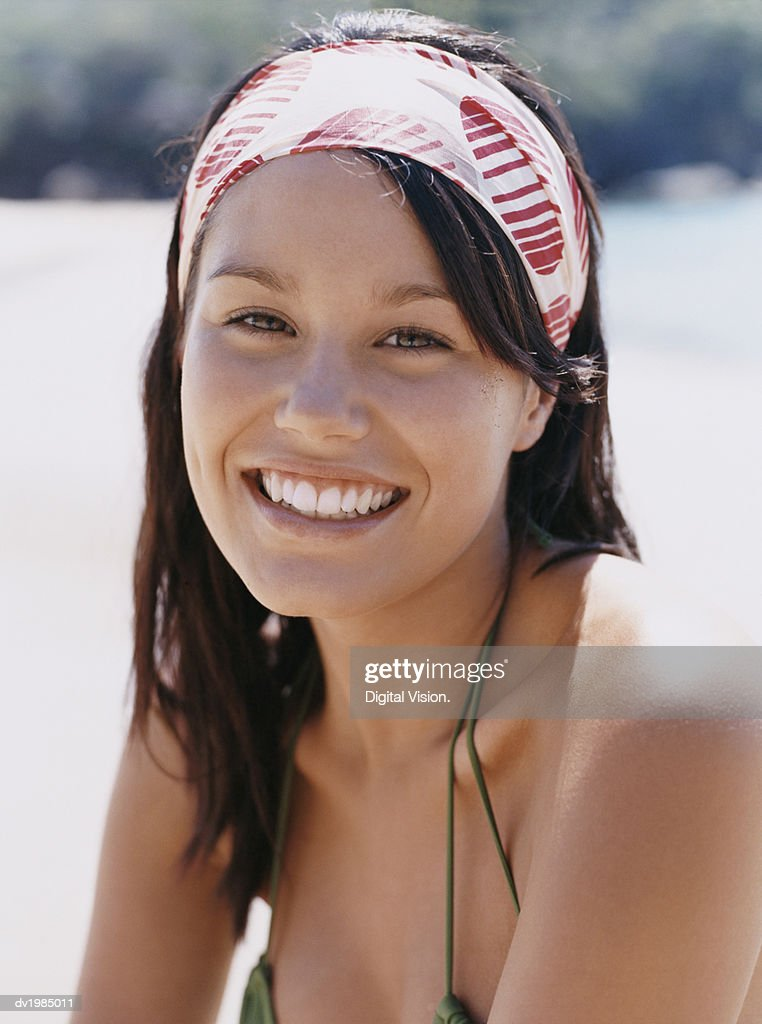 Portrait of a Young Woman Wearing a Hairband : Stock Photo