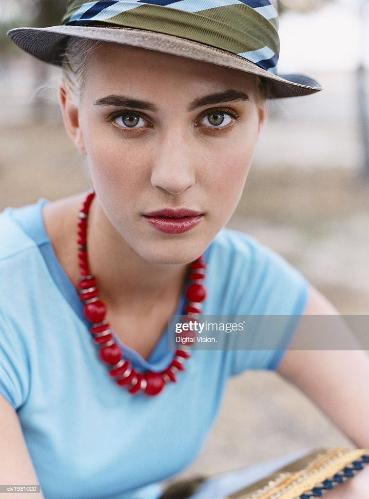 Portrait of a Young Woman Wearing a Hat : Stock Photo