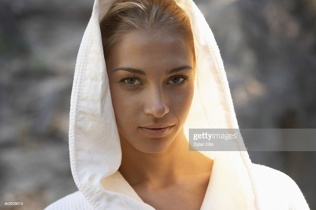 Portrait of a Young Woman Wearing a Hooded Bathrobe : Stock Photo