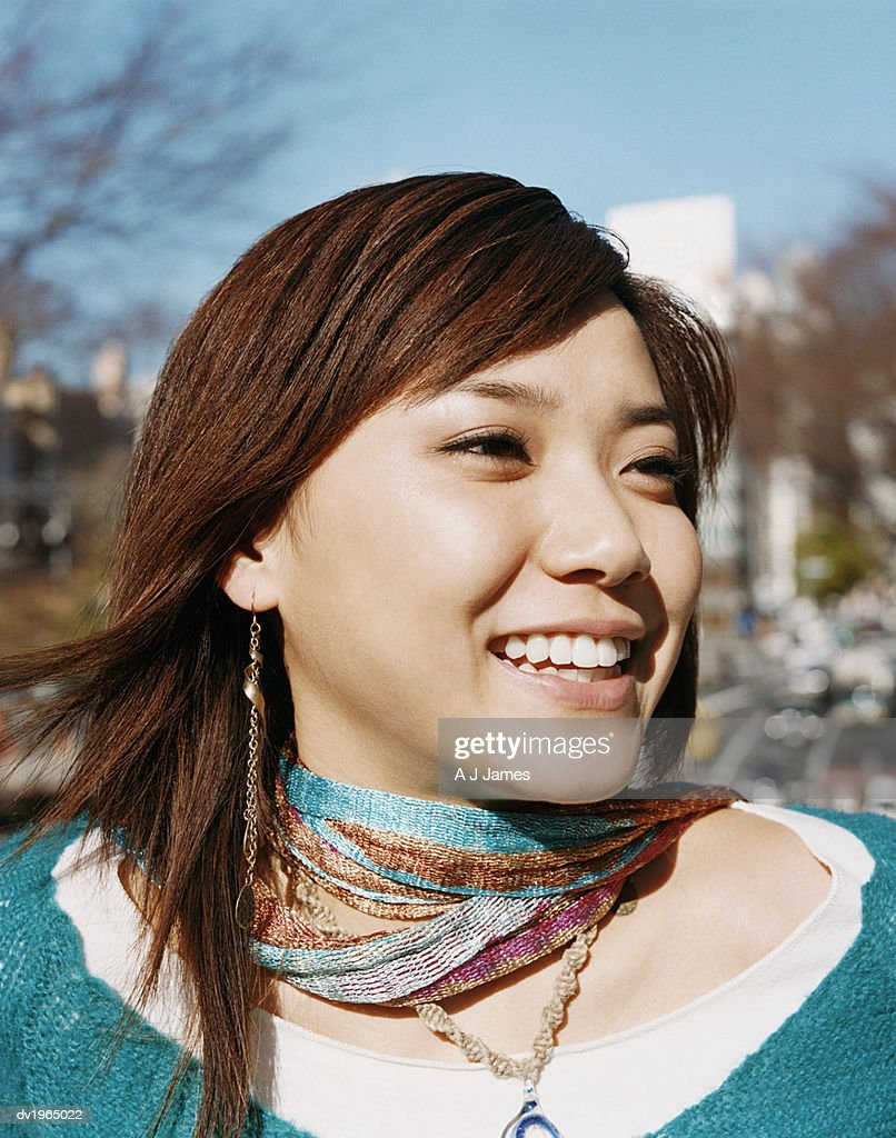 Portrait of a Young Woman Wearing a Scarf : Stock Photo