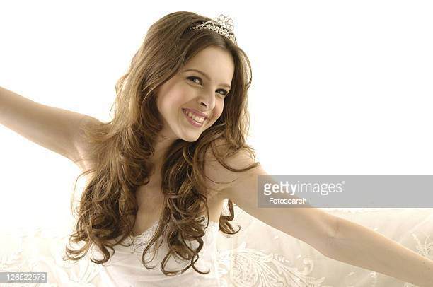 Portrait of a young woman wearing a tiara and smiling