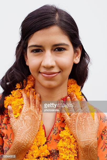 Portrait of a young woman wearing garlands
