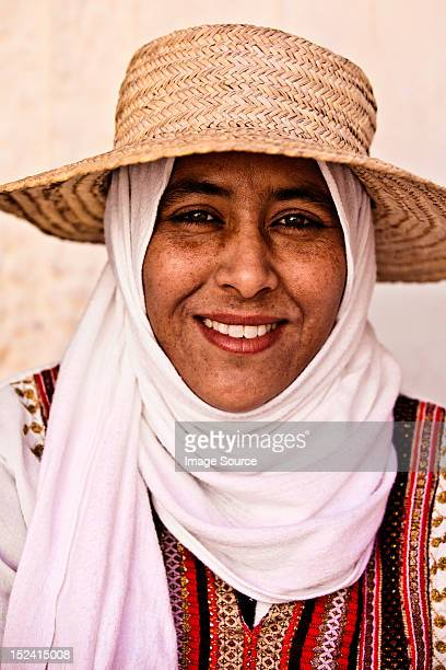 portrait of a young woman wearing hat and headscarf in djerba, tunisia - djerba stock pictures, royalty-free photos & images