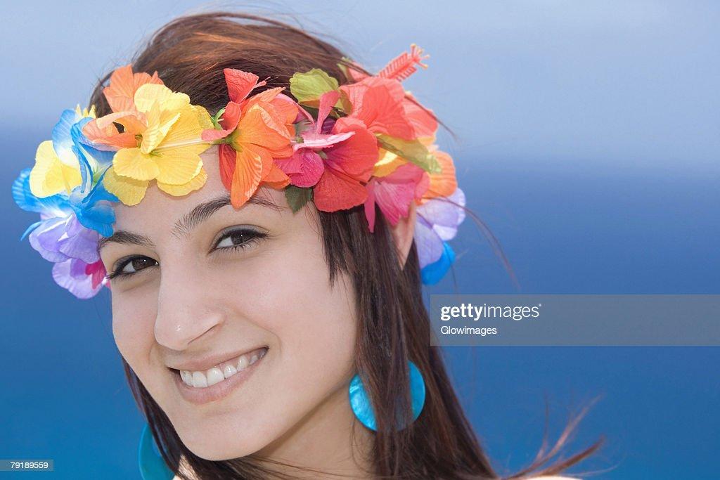 Portrait of a young woman wearing lei and smiling, Diamond Head, Waikiki Beach, Honolulu, Oahu, Hawaii Islands, USA : Stock Photo