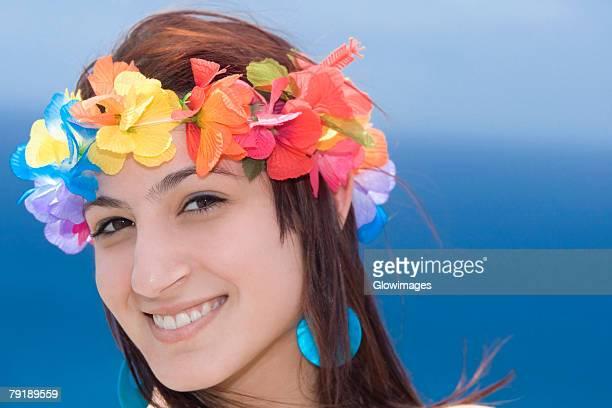 Portrait of a young woman wearing lei and smiling, Diamond Head, Waikiki Beach, Honolulu, Oahu, Hawaii Islands, USA