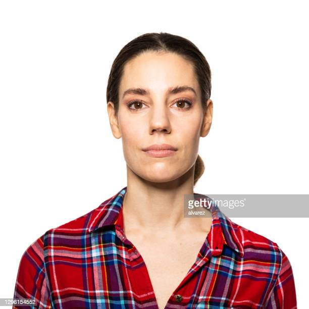 portrait of a young woman wearing plaid shirt - brown hair stock pictures, royalty-free photos & images