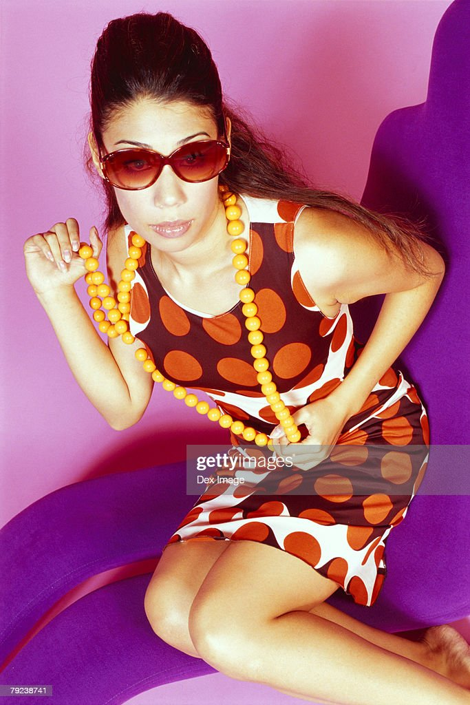 Portrait of a young woman wearing sunglass : Stock Photo