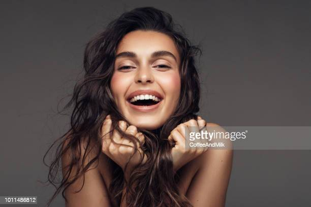 portrait of a young woman with a beautiful smile - long hair stock pictures, royalty-free photos & images