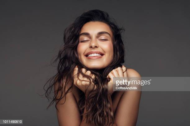 portrait of a young woman with a beautiful smile - freshness stock pictures, royalty-free photos & images