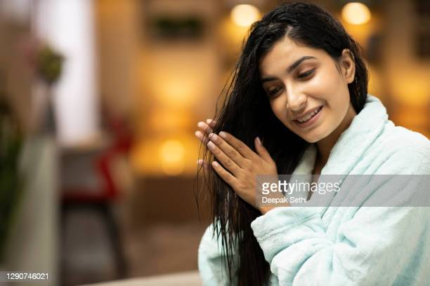 portrait of a young woman with a beautiful smile stock photo - essential oil stock pictures, royalty-free photos & images