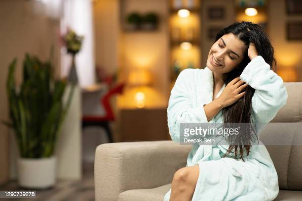 portrait of a young woman with a beautiful stock photo - hair care stock pictures, royalty-free photos & images