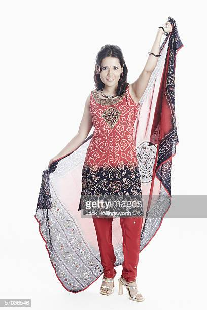 portrait of a young woman with a stole in her hand posing - salwar kameez stock pictures, royalty-free photos & images